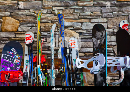 Skis and Snowboards leaning against the Roundhouse Lodge on Whistler mountain - Stock Photo