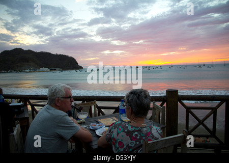 Colorful sunset on the beach at San Juan del Sur, Nicaragua - Stock Photo