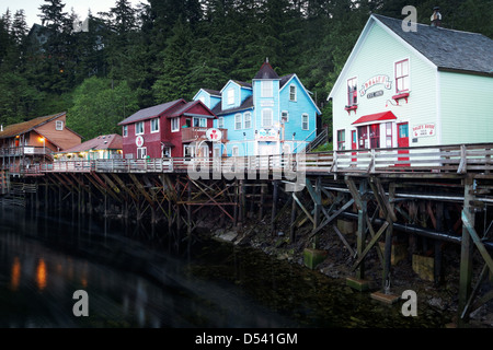 Dolly's House and other buildings on pilings above Ketchikan Creek, historic Creek Street, Ketchikan, Alaska - Stock Photo