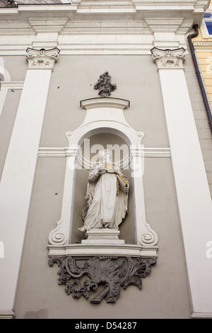 Statue in the exterior niche of St Michael 18th century church in Budapest, Hungary. - Stock Photo