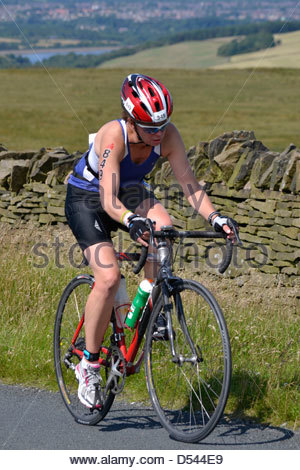 Competitor taking part in the Bolton Ironman, July 2012, in spectacular scenery - Stock Photo