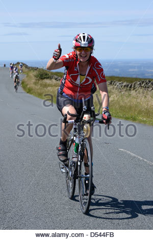 Thumbs up from a competitor taking part in the Bolton Ironman, July 2012, in spectacular scenery - Stock Photo