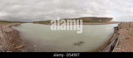 Panoramic view of the mouth of the Cuckmere Haven with river waterway estuary - Stock Photo