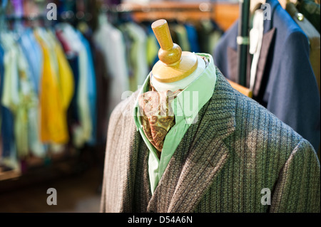 Stylish vintage men's tweed jacket, waistcoat, shirt and cravat on display at a retro clothes fair - Stock Photo