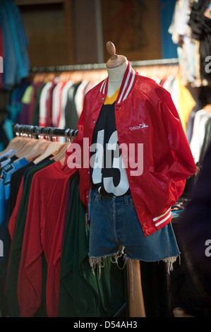 Bright red vintage American teen college jacket on a display at a vintage clothes fair - Stock Photo