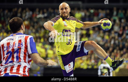 Berlin's Konstantin Igropulo vies for the ball with Madrid's Joan Canellas Reixach (L) during the handball Champions - Stock Photo