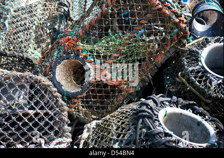 Close up of a pile of unused lobster pots on harbour side - Stock Photo