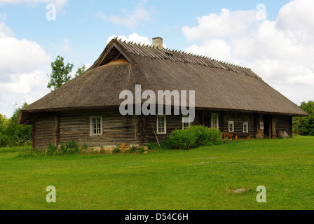 Old traditional log house / cottage in Estonia - Stock Photo