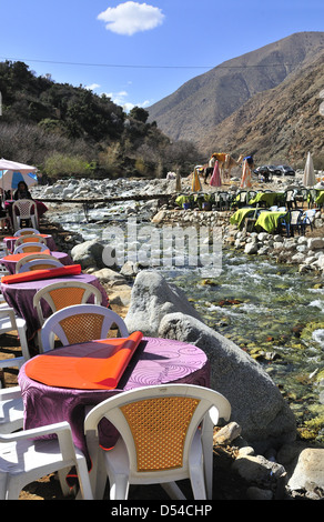 River sides eateries line the river side of the popular Setti Fatma near Cascades, Ourika Valley ,Morocco - Stock Photo