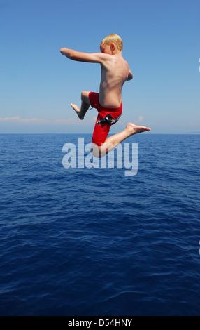Portoferraio, Italy, a boy jumping into the sea, bay Sansone - Stock Photo