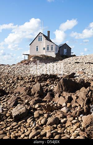 Fishermen's house on sea shore on Ecrehous island off Jersey, Channel islands, UK - Stock Photo