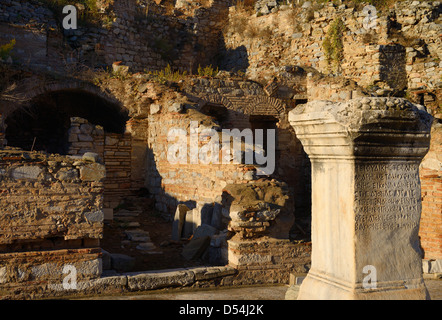Greek inscription on stone column base at the Slope Houses on Curetes street in ancient Ephesus Turkey - Stock Photo