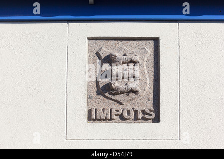 Impots plaque and shield on customs house Ecrehous island Jersey Channel islands UK - Stock Photo