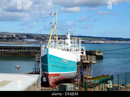 A fishing trawler in dry dock for repairs at Newlyn, Cornwall, UK - Stock Photo