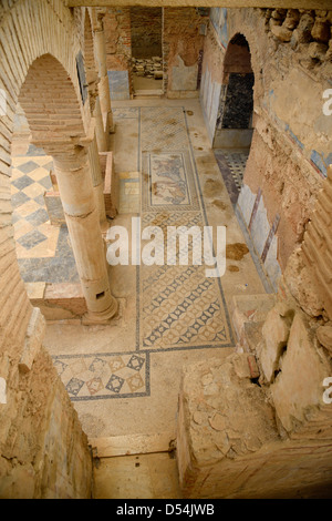 Arches and mosaic tile floor of interior Slope House ruin on Curetes street of ancient Ephesus Turkey - Stock Photo