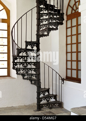decorative 19th century cast iron spiral stair between levels at textile mill converted to Center for the Arts San - Stock Photo