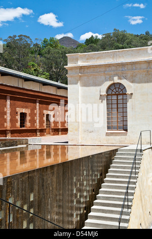 reflecting pool & spillway at staircase leading to entrance of Center for the Arts via the back of converted textile - Stock Photo