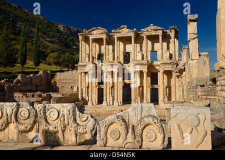 View of ruins surrounding the Library of Celsus from the Marble Street in ancient Ephesus Turkey - Stock Photo