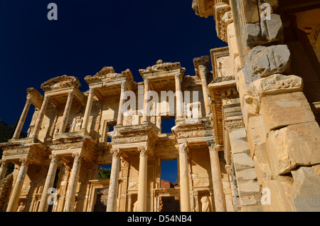 Ruins of the facade of the Library of Celsus from the Agora archway at ancient city of Ephesus Turkey on clear blue - Stock Photo