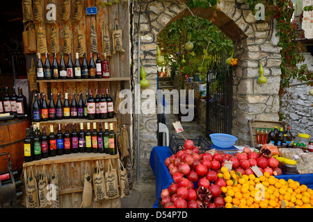 Fresh pomegranate oranges olive oil and fruit wines at a shop in rural town of Sirince Turkey - Stock Photo