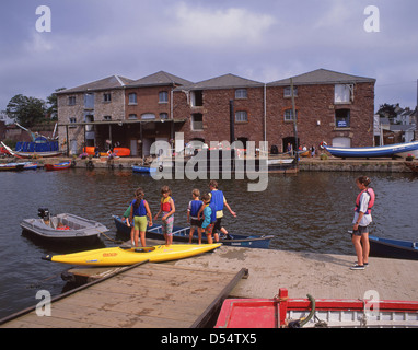 Floating wharf and children in kayaks, Exeter Historic Quayside, Exeter, Devon, England, United Kingdom - Stock Photo