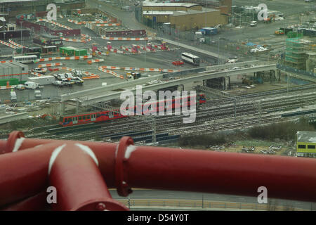 London, UK. 24th March 2013. A Dockland Light Railway train seen from the 15-metre-high (377 ft) ArcelorMittal Orbit - Stock Photo