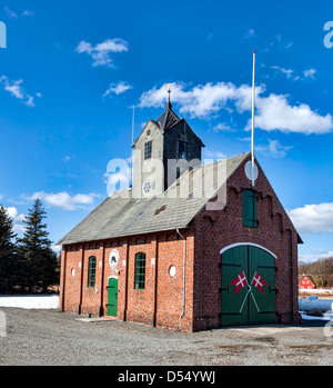 Old fire station on Romoe in the Danish wadden sea - Stock Photo