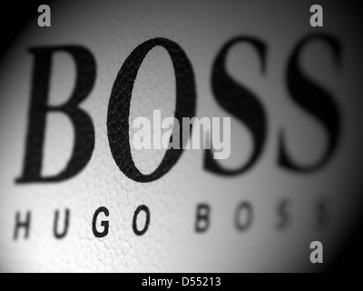 Hugo Boss logo with selective focus on the letters GO - Stock Photo