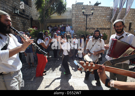 Klezmer (traditional Jewish musicians) play music in a street in Safed - Stock Photo