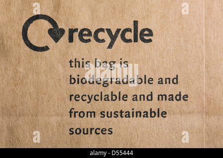 Recycle logo on a brown paper bag. - Stock Photo