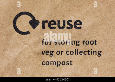 Reuse logo on a brown paper bag. - Stock Photo