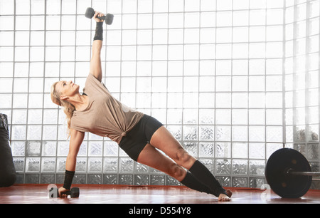 Woman working out in gym - Stock Photo