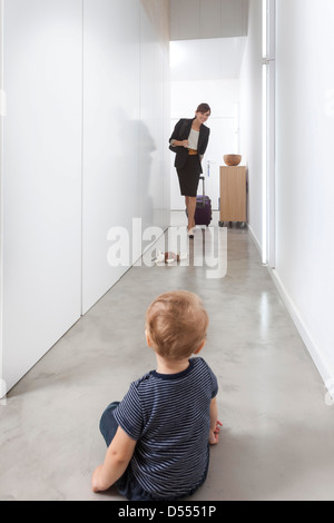 Mother returning from business trip - Stock Photo