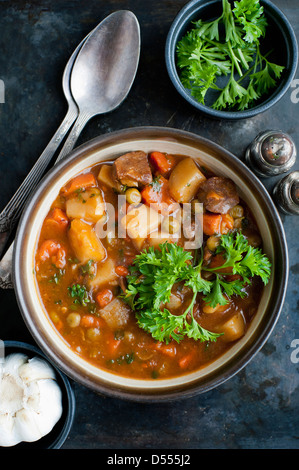 Bowl of stew with herbs - Stock Photo