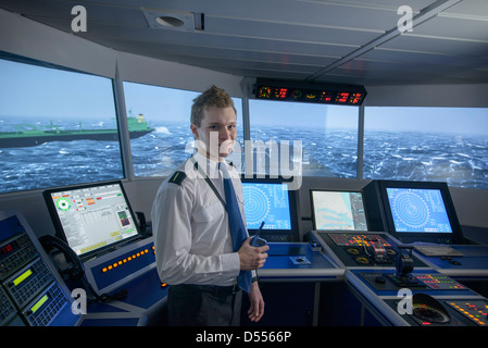 Personnel standing on ships bridge - Stock Photo