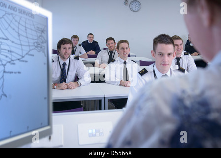 Students in shipping training room - Stock Photo