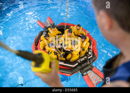 Oil workers learning survival strategies - Stock Photo