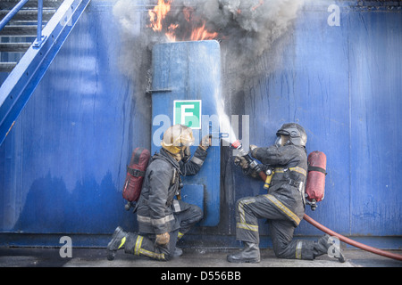Firefighters in simulation training - Stock Photo