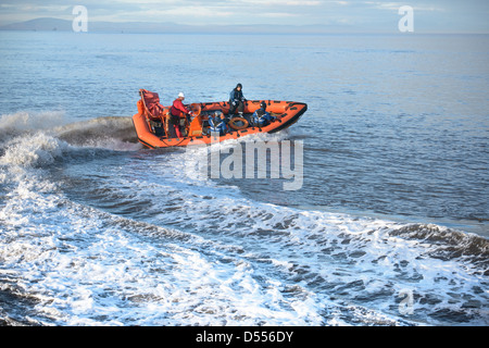 Rescue boat training in open water - Stock Photo