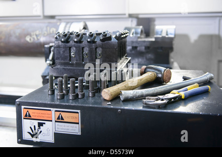 Nuts and bolts on industrial lathe - Stock Photo