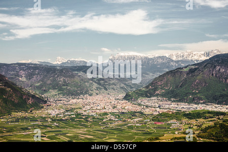 Aerial view of town in rural valley - Stock Photo