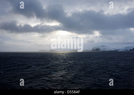 snow covered cliffs and rugged arctic coastline northern norway europe - Stock Photo