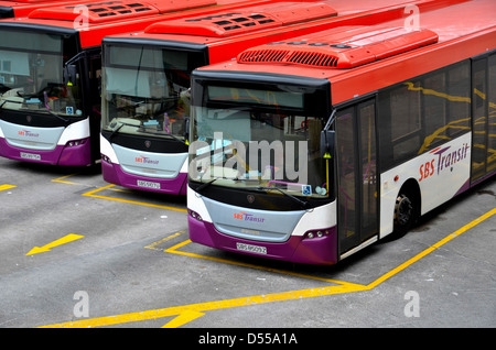Public commuter buses at bus terminal - Stock Photo