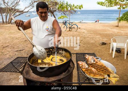 Red snapper (Lutjanus campechanus) being prepared on the beach in Ocotal, Guanacaste Province, Costa Rica. - Stock Photo