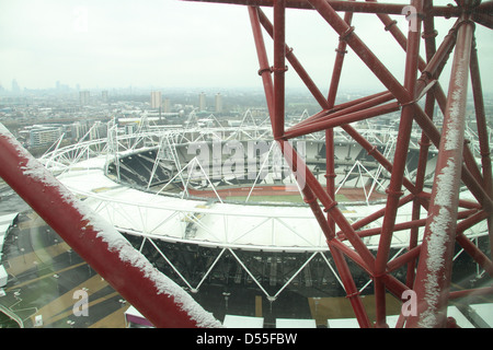 The Olympic stadium seen from the  115-metre-high (377 ft) ArcelorMittal Orbit observation tower in Stratford - Stock Photo