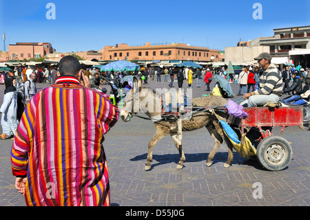 Typical of the daily hubbub of traders and tourists crowds in Jemaa el- Fnaa ( Square) . Marrakesh, Morocco - Stock Photo
