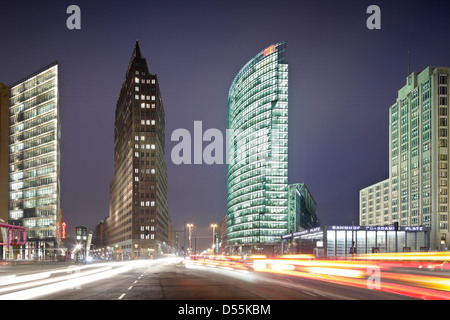 Berlin, Germany, illuminated front buildings at Potsdamer Platz at night - Stock Photo