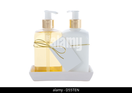 two Hair and Skin care bottles on a stand on a white background - Stock Photo