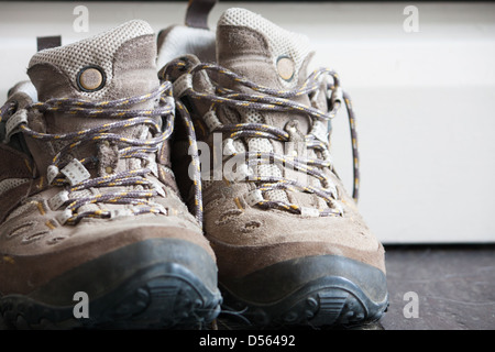 A pair of old worn hiking shoes close up - Stock Photo