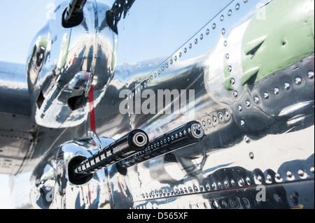Mounted guns reflect in the polished chrome of a World War II era Mitchell B-25 Bomber at a Columbus, Georgia air - Stock Photo